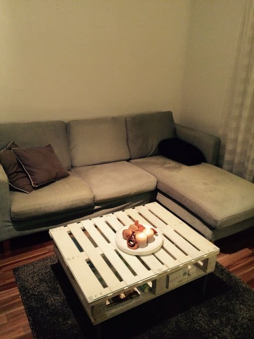 A couch to feel home and comfy with a selfmade table
