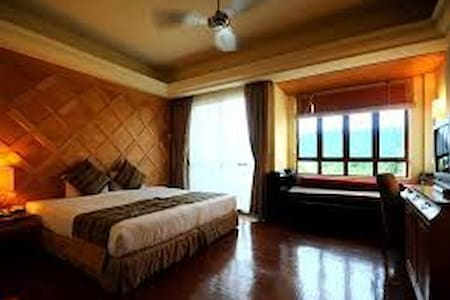 room with king size and  sofa bed