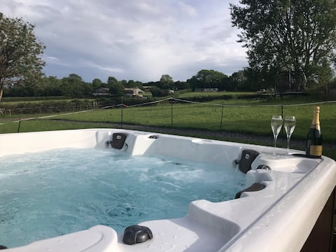 Watch planes land from hot tub by Bristol Airport