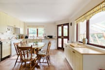 Modern kitchen with range oven, large fridge freezer and separate small fridge, comb oven and microwave - you will have no problem catering for a large group here!
