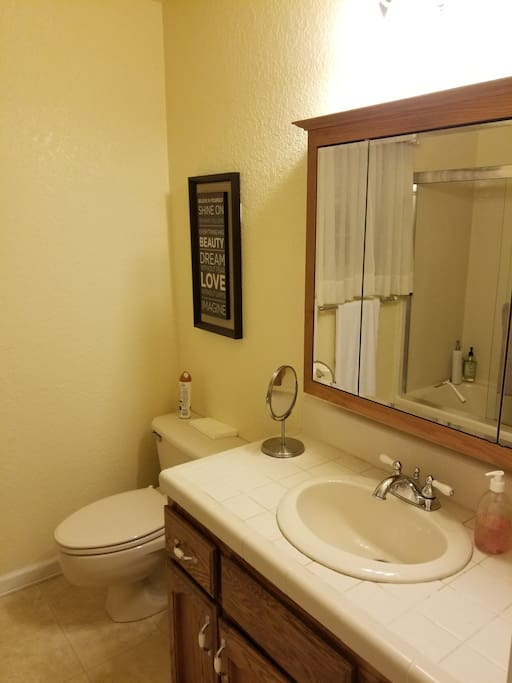 Cozy shared hall bathroom nearby with tub and shower.