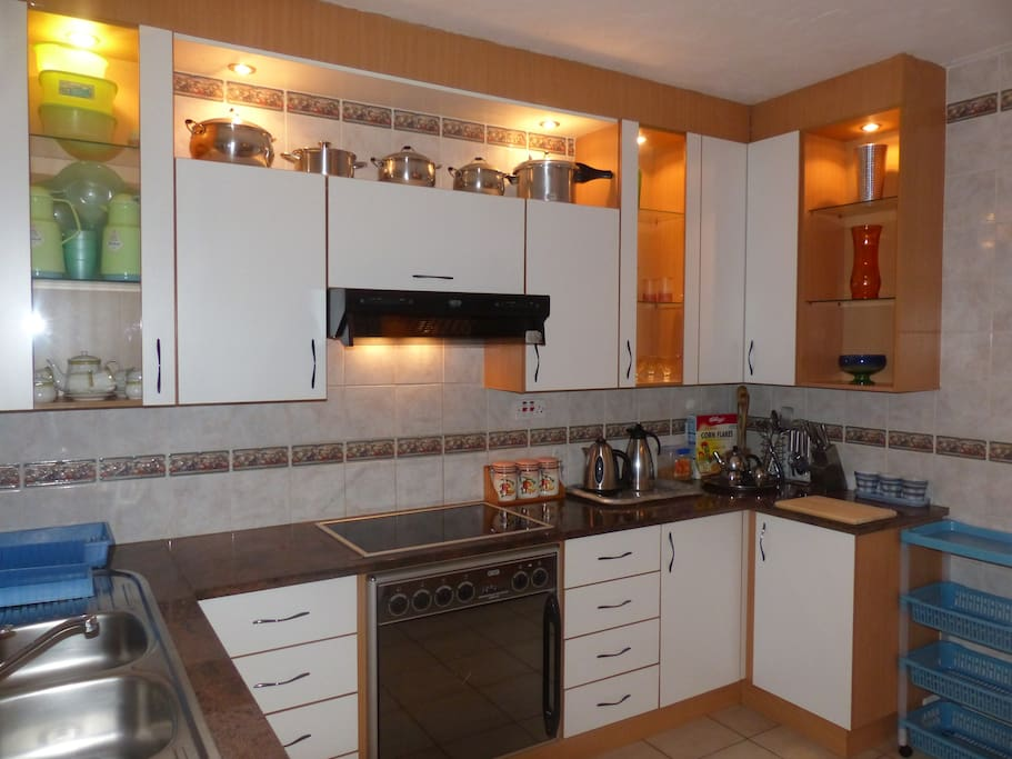 modern fully functional kitchen with granite tops