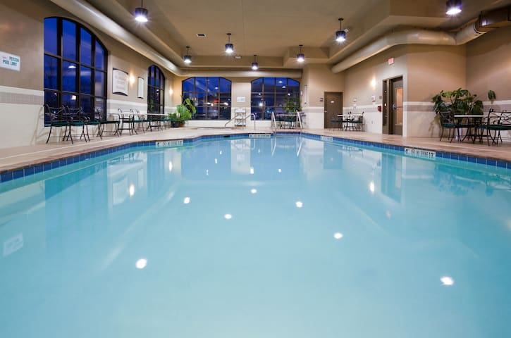 24 Hour Business Center + Indoor Pool + Hot Tub | Close to the Airport!
