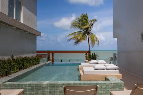 Flat foot on the sand with ocean views in the Caribbean