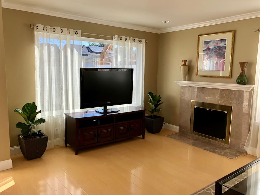 """Shared living room with 48"""" Smart Apple TV"""