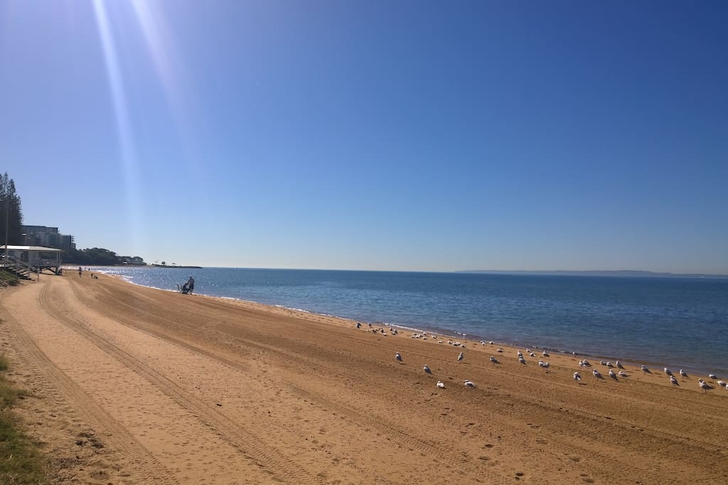 Stroll along the sandy beach to cafes for coffee, a  meal or local attractions