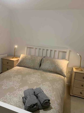 Double bed with modern side tables and lighting