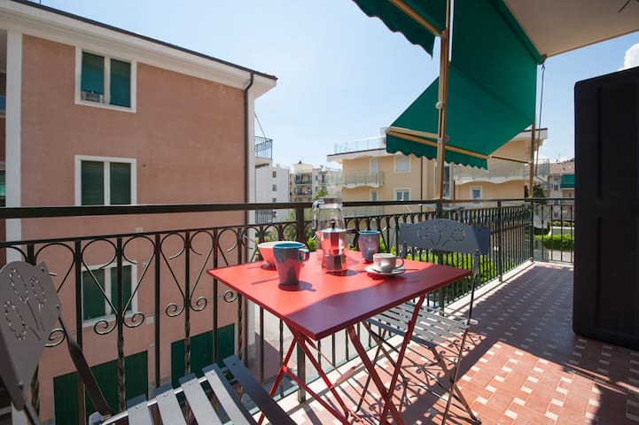 balcony with awnings table and chairs