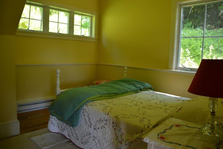 First floor bedroom has a full size bed. Bedroom #2