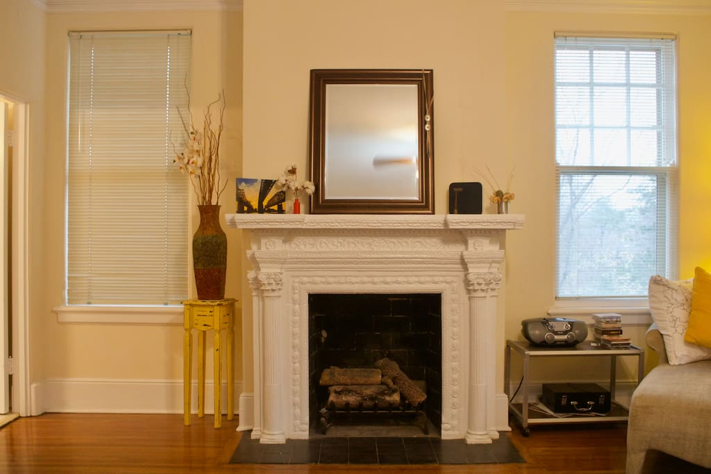 The fireplace adds a touch of home that lets you really curl up and relax in this charming room.