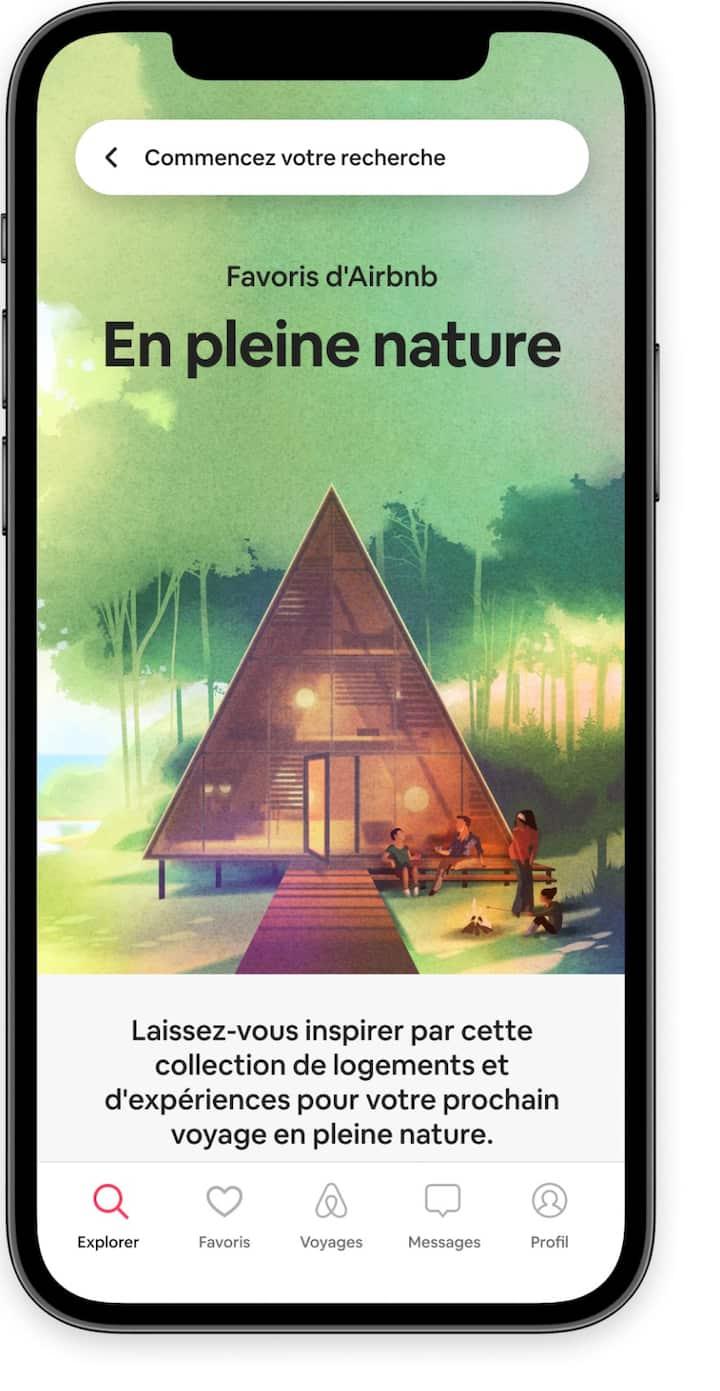 L'écran d'accueil qui met en avant la collection de favoris En pleine nature dans l'application Airbnb.