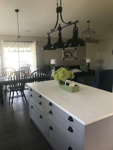 Kitchen and dining room area with additional Island seating featuring quartz countertop.