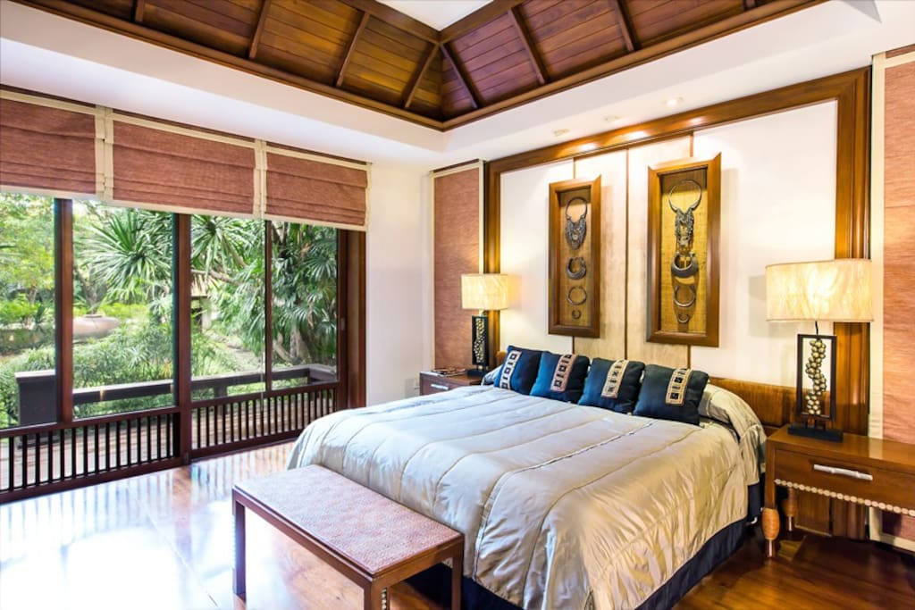 King sized bed with large veranda  and private pool access