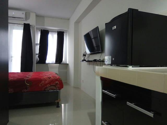 Comfy Room at Grand Sentraland Apartment Karawang