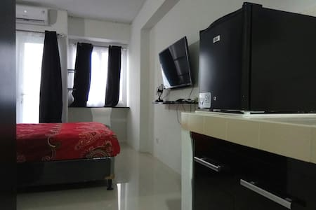 Comfy Room at Grand Sentraland Apartment Karawang