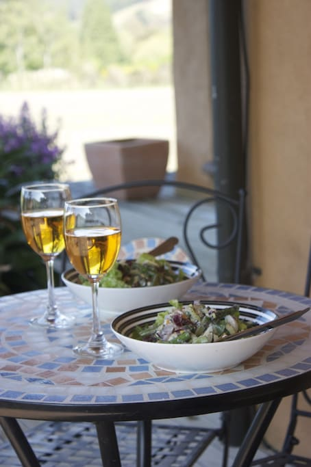 Relax outside on the deck with a glass of wine