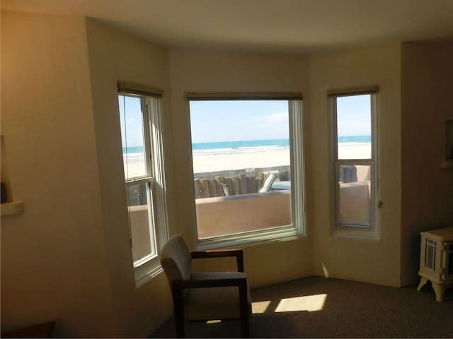 looking out living room bay window towards beach