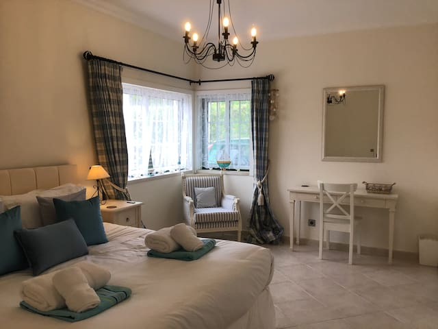 Bedroom 1 with en-suite. These beds can be made into 2 single beds or joined to form a super king sized bed. It is air conditioned and contains a desk and arm chair.