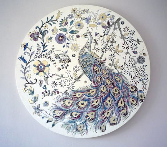 Peacock painted onto fabric in your bedroom