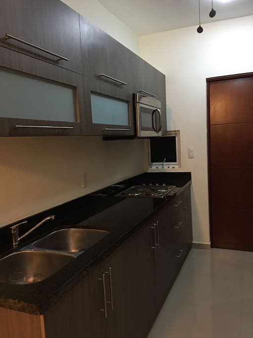 new kitchen, microwave, stove and dishes