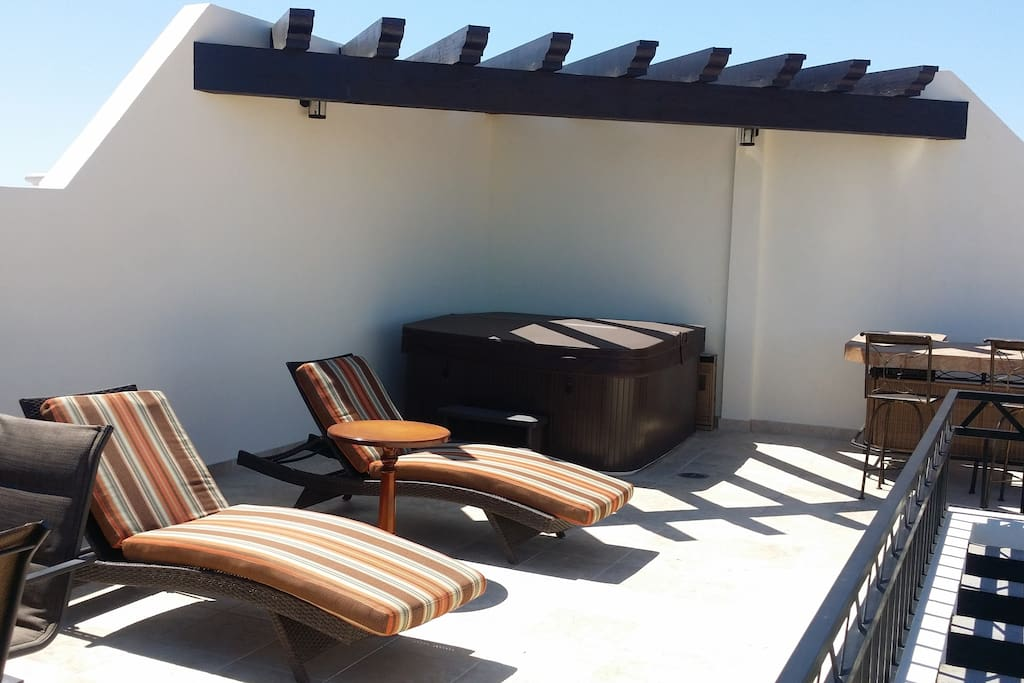 Your spacious, private rooftop deck has dining table, 4 chaise lounges, bar and jacuzzi.