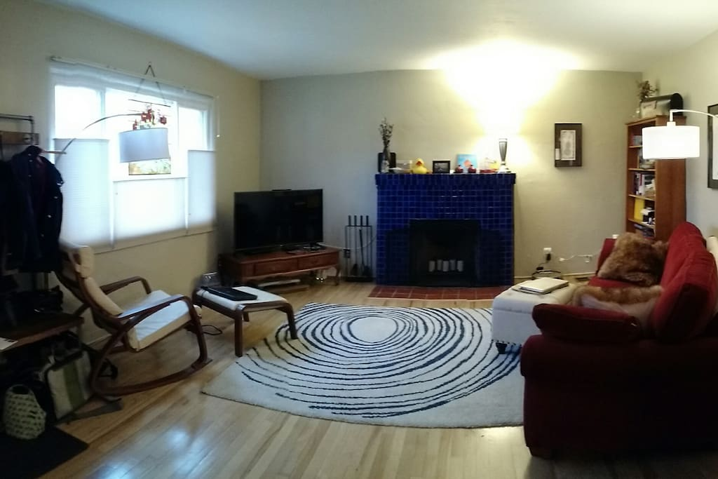 Sunny, west facing living room with working fireplace