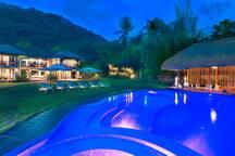 The villa at night.