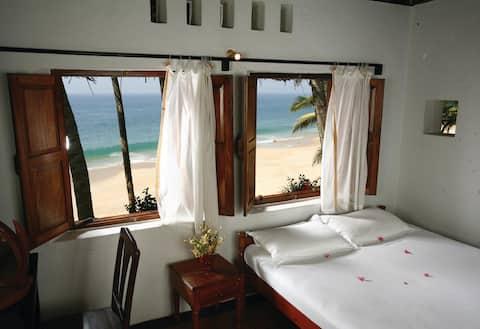 Sea Breeze AC -Suite in Karikkathi Beach House.