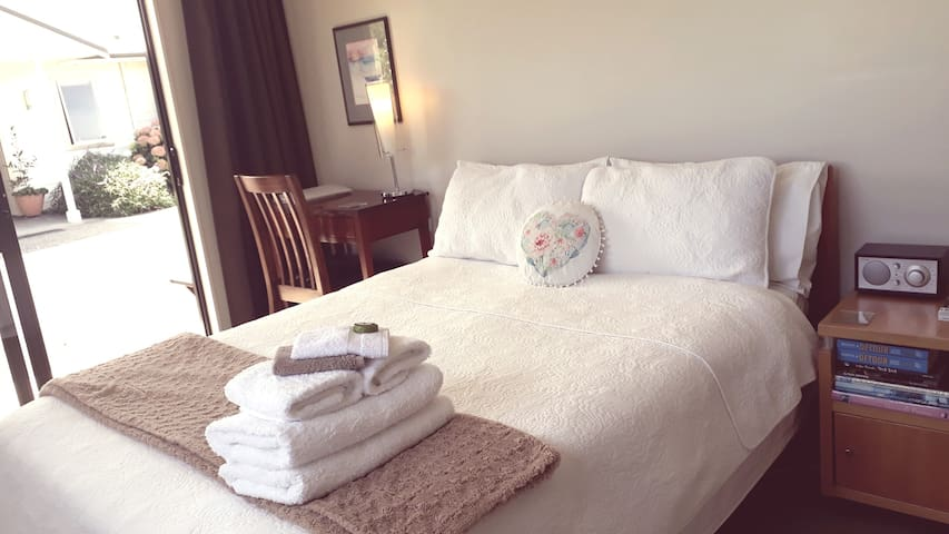 You will sleep in a comfortable double bed with locally made mattress and wool filled duvet. The room is small but light and airy.