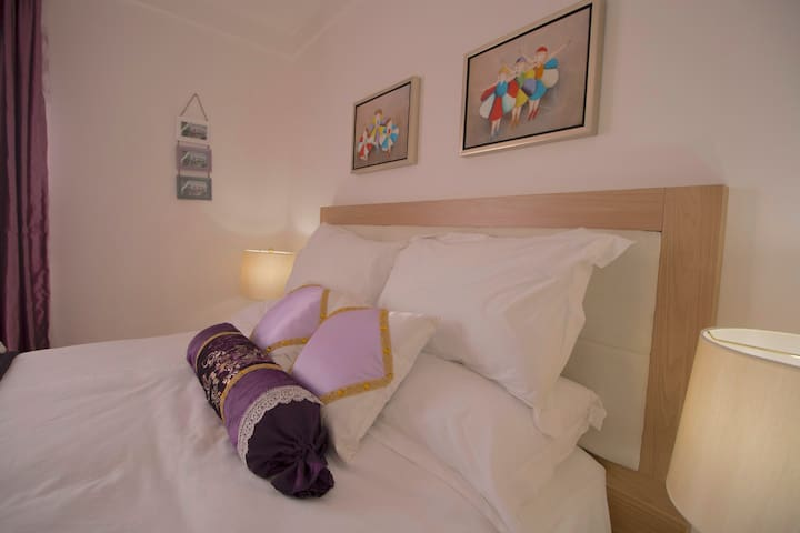 Royal purple room with a comfortable queen size bed