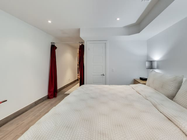 Bedroom #3 on lower level - private. California King bed with pillowtop mattress, closet.