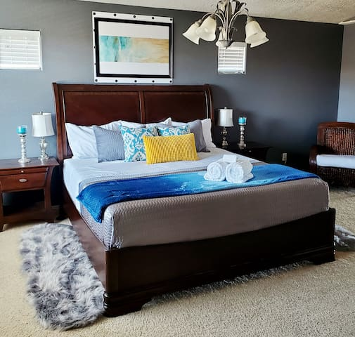 Spacious stylish Master bedroom with king size bed, large  attached bathroom and walk in closet