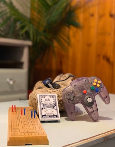 Enjoy a hint of Nostalgia! A Nintendo 64 complete with Mario Kart, Mario 64 and a few other games! A deck of cards for endless amount of fun!