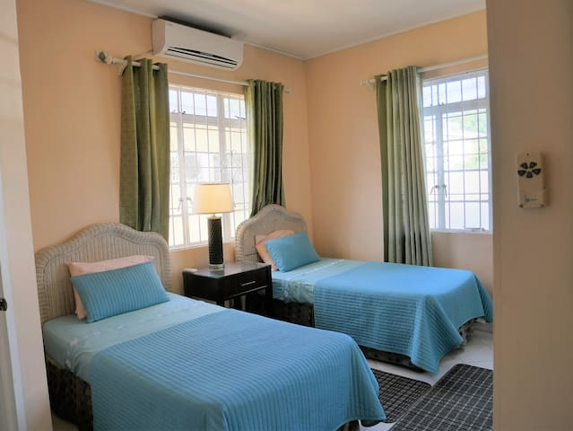 Second bedroom has twin beds (they can push together) a/c, ceiling fan, ensuite bathroom