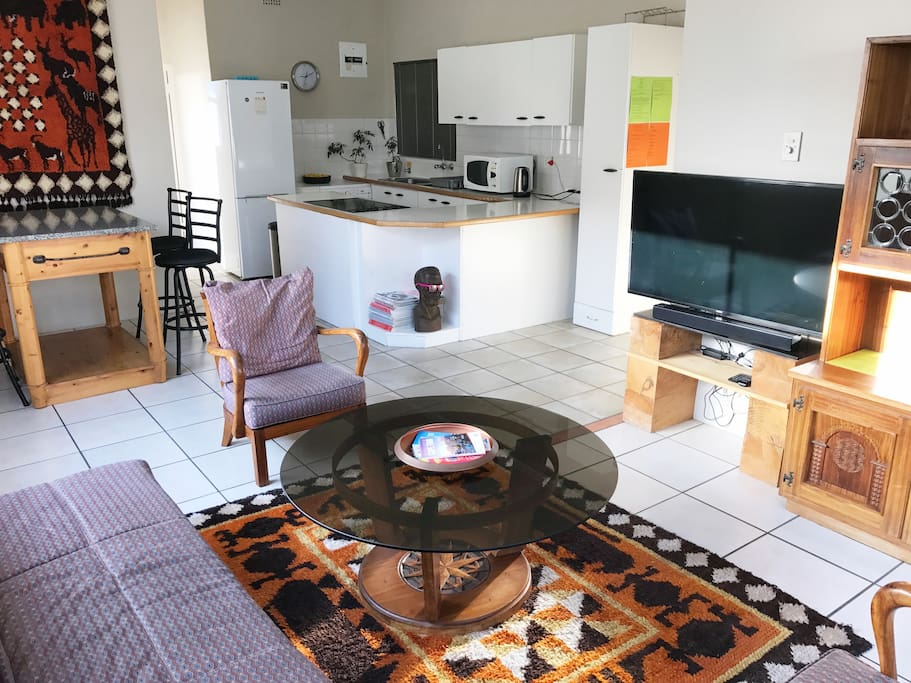 lounge, dining table and open plan kitchen