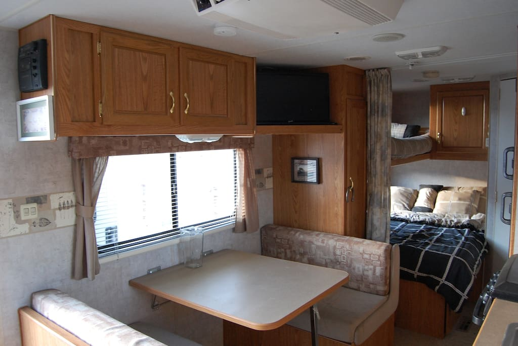 Dining/Breakfast table that folds down into a bed. TV and separate Radio/CD player