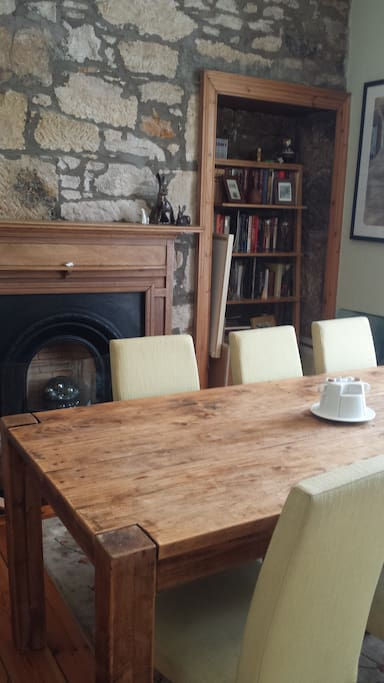 Dining room, seats for 6 people.  This is a large room with open fireplace, and bay window.