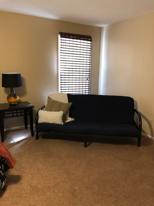 Futon in bedroom, could serve as another bed