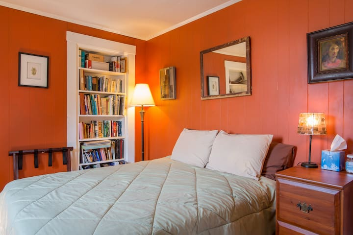 Bedroom with a full (double) bed, memory foam topper, and plush pillows