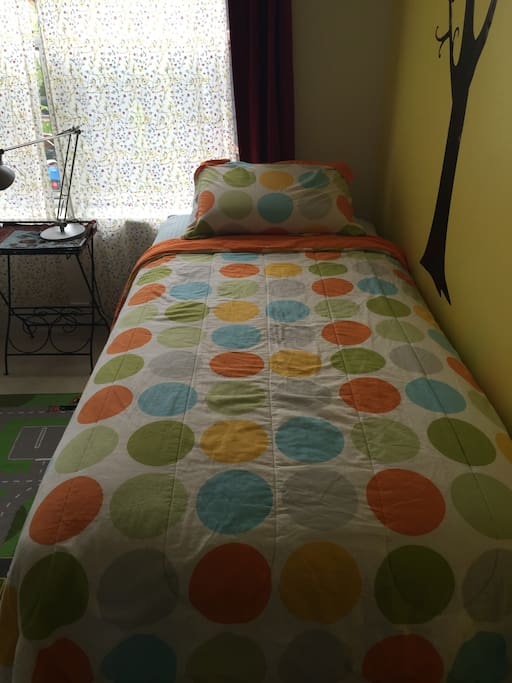 Twin XL bed is brand new and super comfortable. The room also has another single bed with a comfortable high density foam mattress.