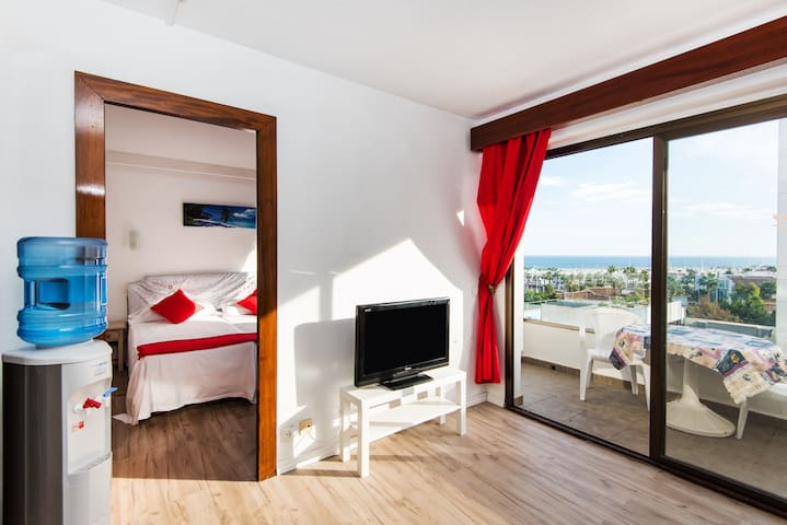 "Charming Holiday Apartment ""Apartamento 1 linea de playa"" with Sea View, Mountain View, Wi-Fi, Terrace & Shared Pool"