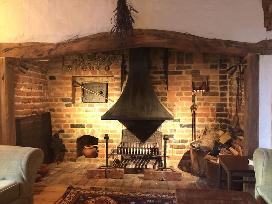 Living room: cosy seating in front of original inglenook and breadoven