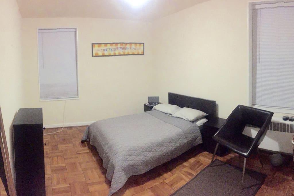 Cozy queen-sized bedroom.