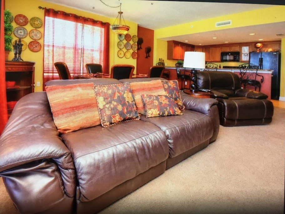Living Room With Plenty Of Space & Seating For All Guests