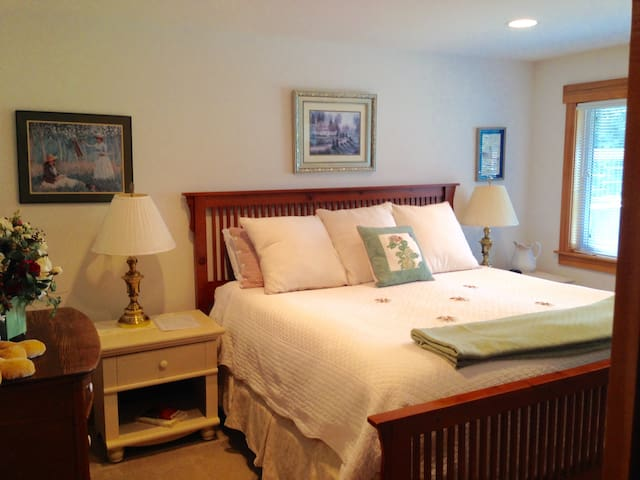 Master suite with view of Lone Lake, King bed, walk in closet with crib and private bath.