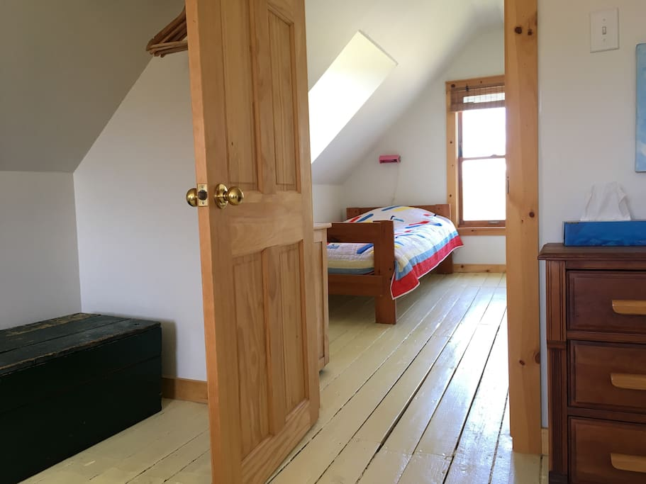 There are extra pillows and blankets in the wooden chest. There is a single bed in the outer room for an extra grownup or child.