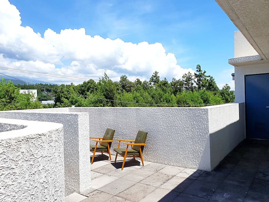SUN DECK with view of Mt halla in the background.