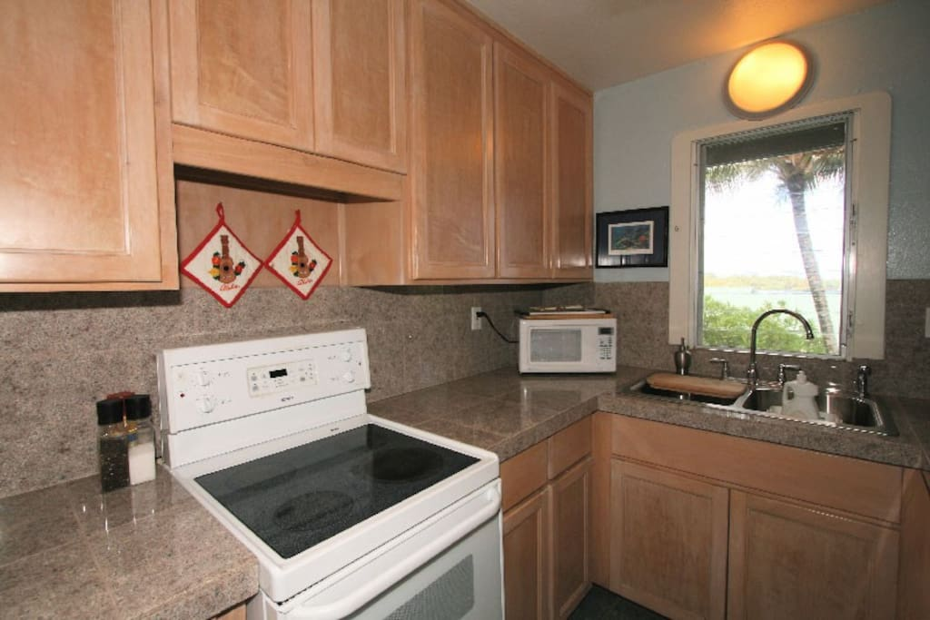 Kitchenette with apartment size appliances and plenty of tools for cooking