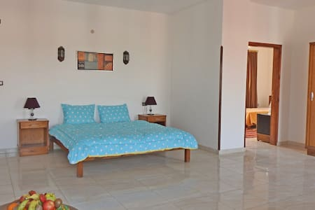 Master bedroom of the Junior Family suite; connecting door to the second bedroom for 2 or 3 persons, with separate bathrooms.
