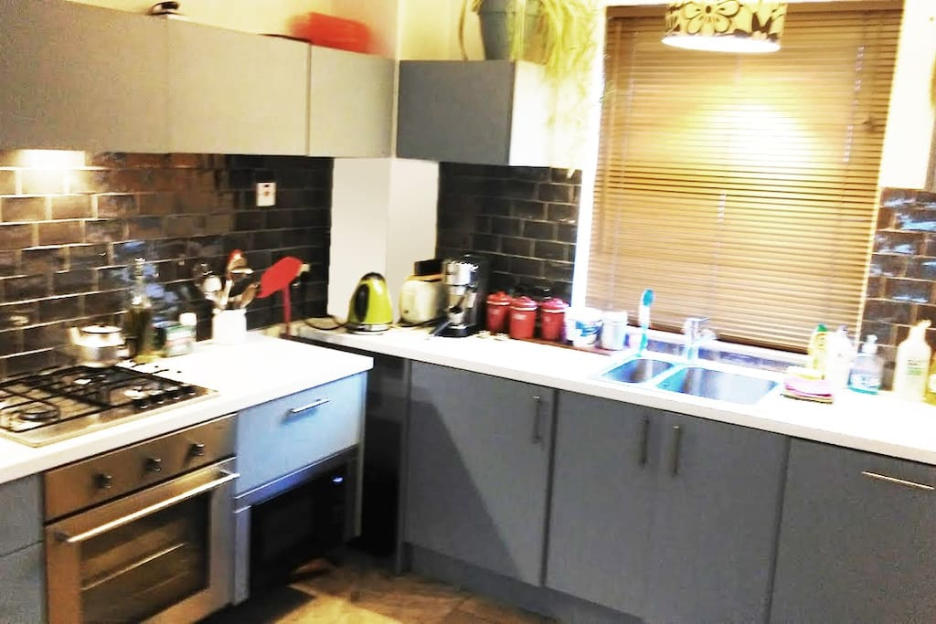 Kitchen - this shows new tiled splash-back behind cooker and sink areas
